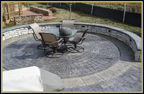 Stamped Concrete Circle with Separate Color Border, Stone Walls with Custom Lighting