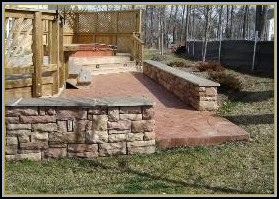 Stamped Random Stone Patio with Stone Walls