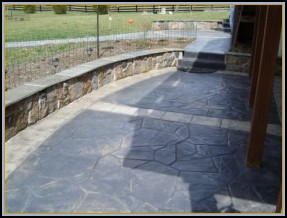 Stamped Concrete Flagstone Patio with Stone Seating Walls