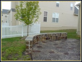 Stamped Random Stone Patio with Stone Wall