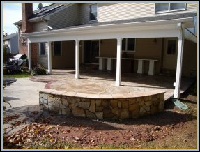 Stamped Flagstone Patio with Wall