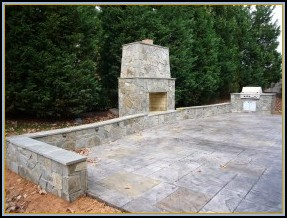 Stamped Old English Stone Patio with Fireplace and Grill
