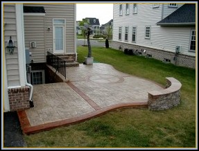 Ashler Stamped Concrete Patio with Compass Artwork