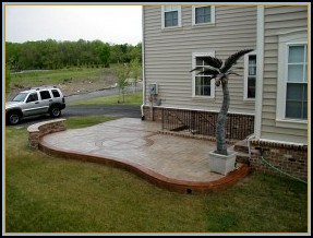 Ashler Patio with Borders and Stone Seating Wall