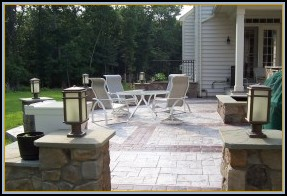 Stamped Ashler Slate Patio with Borders and Stone Walls