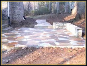 Stamped Flagstone Patio with Acid Staining and Wall